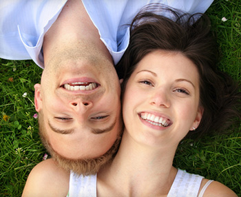 Couple smiling with CEREC technology in Juno Beach