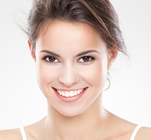 Girl smiling after beautiful cosmetic dentistry in West Palm Beach